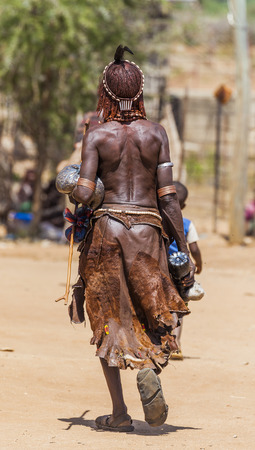 TURMI, OMO VALLEY, ETHIOPIA - DECEMBER 30, 2013: Unidentified Hamar woman at village market. Weekly markets are important events in Omo Valley tribal life.