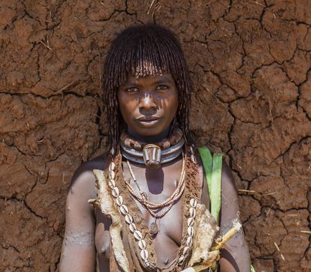 TURMI, OMO VALLEY, ETHIOPIA - DECEMBER 30, 2013: Unidentified Hamar woman at village market. Weekly markets are important events in Omo Valley tribal life.