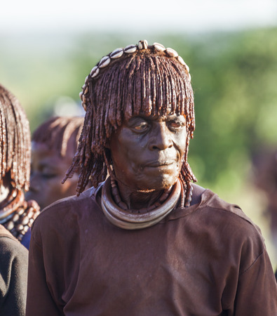 manhood: TURMI, OMO VALLEY, ETHIOPIA - DECEMBER 30, 2013: Portrait of unidentified mature Hamar woman at bull jumping ceremony. Jumping of the bull is a rite of passage into manhood in some Omo Valley tribes.