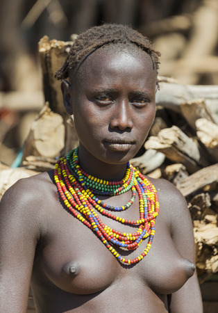OMORATO, LOWER OMO VALLEY, ETHIOPIA - JANUARY 31, 2012:  Portrait of unidentified Dassanech girl. Omorato one of the poorest places in Ethiopia. Sajtókép
