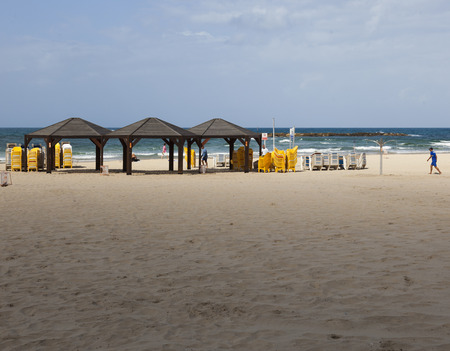 despite: TEM AVIV, ISRAEL - OCTOBER 19, 2014: Geula Beach. Despite hot weather, October in Israel considered a shoulder season, so beaches are not packed too much.