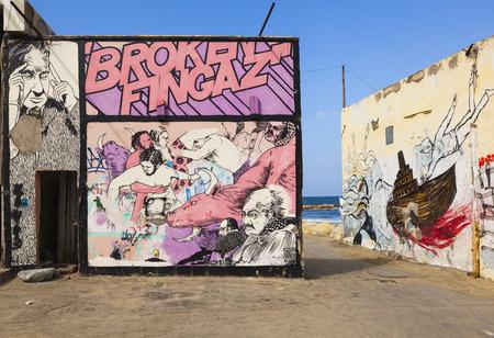 yaffo: TEL AVIV, ISRAEL - OCTOBER 19, 2014: Street art (graffiti) by Broken Fingaz near wreck of Dolphinarium Discotheque. Editorial
