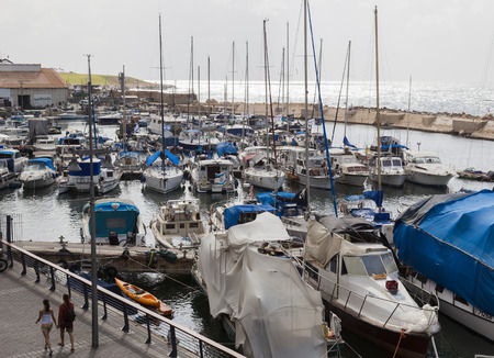 yafo: TEL AVIV - YAFO, ISRAEL - OCTOBER 19, 2014: Yachts motorboats and fishing vessels in Old Jaffo Port Editorial
