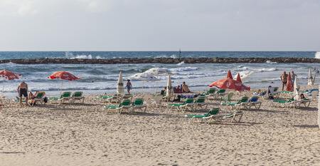 despite: TEL AVIV, ISRAEL - OCTOBER 19, 2014: Banana Beach. Despite hot weather, October in Israel considered a shoulder season, so beaches are not packed too much.