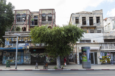 TEL AVIV, ISRAEL - OCTOBER 20, 2014: Unrenovated houses on Rehov Allenby Street.