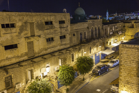 templars: AKKO, ISRAEL - OCTOBER 22, 2014: Streets of ancient city of Akko at night. The place changed very little in several hundreds of years. Editorial