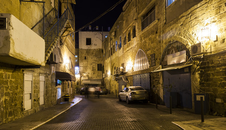 akko: AKKO, ISRAEL - OCTOBER 22, 2014: Streets of ancient city of Akko at night. The place changed very little in several hundreds of years. Editorial