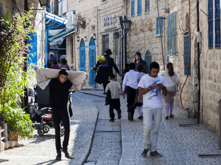 jewish home: TZFAT SAFED, ISRAEL - OCTOBER 24, 2014: Busy city street. People are getting ready for Shabbat celebration. Tzfat Safed is spiritual and artistic centre of Israel.
