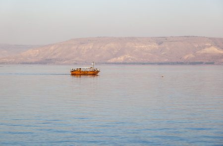 israelis: TIBERIAS, LOWER GALILEE, ISRAEL - OCTOBER 24, 2014. Boat on Sea of Galilee. Tiberias is a favourite holiday destination for many Israelis.