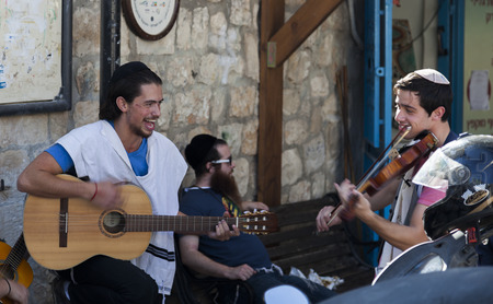 TZFAT SAFED, ISRAEL - OCTOBER 24, 2014: Pre Shabbat celebration on one of the streets. Tzfat Safed is spiritual and artistic centre of Israel. Editorial