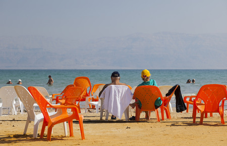 DEAD SEA, ISRAEL - OCTOBER 10, 2014: Unidentified people rest on the Ein Gedi Beach. Dead Sea is the lowest point in earth. Editorial