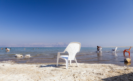 bather: DEAD SEA, ISRAEL - OCTOBER 10, 2014: Unidentified people rest on the Ein Gedi Beach. Dead Sea is the lowest point in earth. Editorial