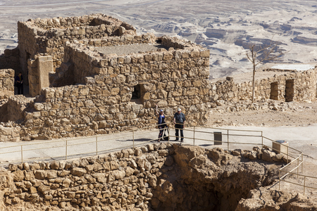 ruins is ancient: ISRAEL, MASADA - OCTOBER 27, 2014: Famous ruins of ancient Masada fortress - one of the most visited places in country