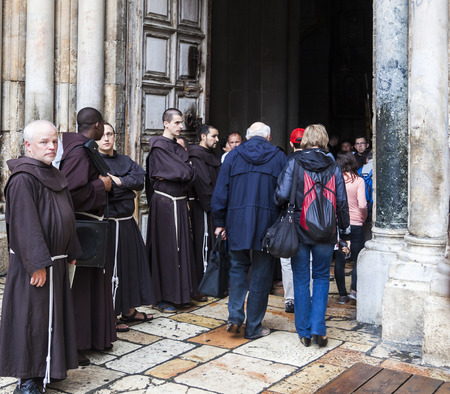 via dolorosa: JRUSALEM OLD TOWN, ISRAEL - OCTOBER 31, 2014: Unidentified people and Fathers from Franciscan Order on traditional Friday Via Dolorosa way of sorrows procession at the entrance of Church of the Holy Sepulchre