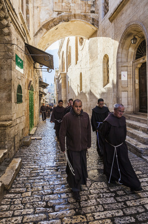 franciscan: JRUSALEM OLD TOWN, ISRAEL - OCTOBER 31, 2014: Unidentified Fathers from Franciscan Order on traditional Friday Via Dolorosa way of sorrows procession.
