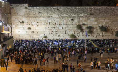 JRUSALEM OLD TOWN, ISRAEL - OCTOBER 31, 2014: Shabbat celebration at Kotel Western Wall. It is usually much more people the on Friday night than any other time of the week. Editorial