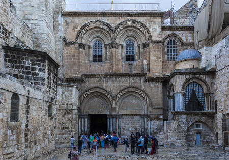 sepulchre: JRUSALEM OLD TOWN, ISRAEL - OCTOBER 31, 2014: Unidentified Pilgrims and tourists on courtyard near the main entrance of Church of the Holy Sepulchre.
