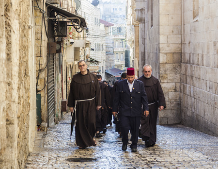 via dolorosa: JRUSALEM OLD TOWN, ISRAEL - OCTOBER 31, 2014: Unidentified Fathers from Franciscan Order on traditional Friday Via Dolorosa way of sorrows procession.