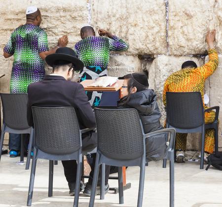 jewish people: JERUSALEM OLD TOWN, ISRAEL - NOVEMBER 2, 2014:  Unidentified Jewish people pray next to Western Wall