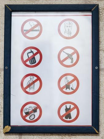 crossed cigarette: Sign at the entrance of Saint James Cathedral. Jerusalem, Israel.