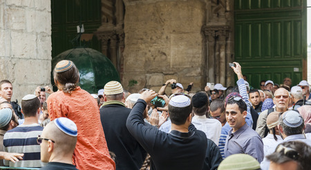 temple mount: JERUSALEM OLD TOWN, ISRAEL - NOVEMBER 2, 2014:  Unidentified Jewish people dance and sing near exit from temple mount. Editorial