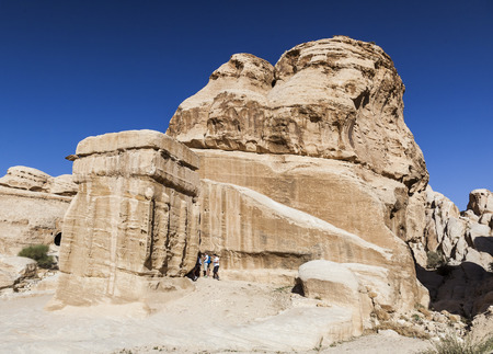 PETRA, JORDAN - OCTOBER 29, 2014: Unidentified tourists near one of the Djinn Blocks - the monuments that served as tombs and memorials to dead. Editorial