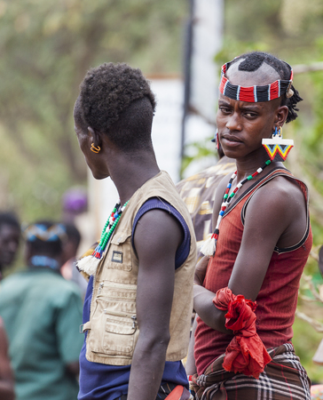 BONATA VILLAGE, OMO VALLEY. ETHIOPIA - JANUARY 2, 2014: Unidentified Boys from Ari tribe at local village market.