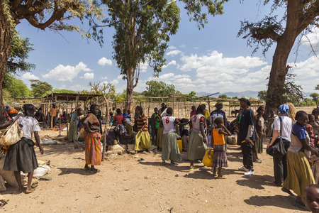NEAR KONSO, OMO VALLEY, ETHIOPIA - JANUARY 3, 2014: Unidentified People from Konso tribal area at local village market. Editorial