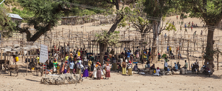 NEAR KONSO, OMO VALLEY, ETHIOPIA - JANUARY 3, 2014: Unidentified people from Konso area tribes at local village market.