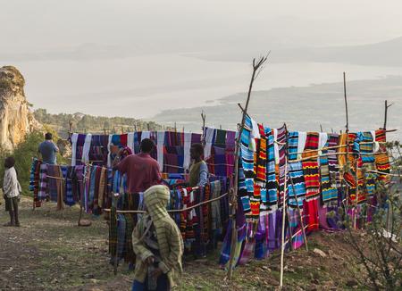 HAYZO VILLAGE, DORZE, OMO VALLEY, ETHIOPIA - JANUARY 3, 2014: Unidentified people at traditional Dorze market. Weaving is a main Dorze people business.