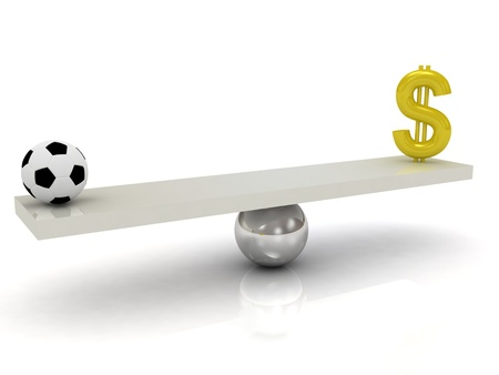Football and money in the balance  Stock Photo