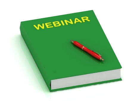 WEBINAR green book and pen on isolated white background    photo