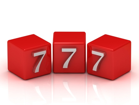 777 number on the red cubes isolated on white background  photo