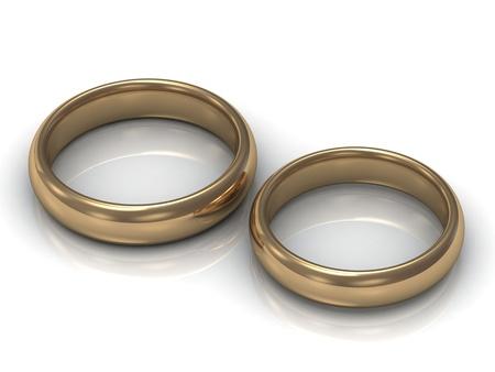 Anillos de bodas del oro para los recién casados ??en un fondo blanco