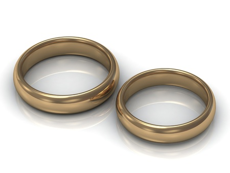 Gold wedding rings for newlyweds on a white background photo