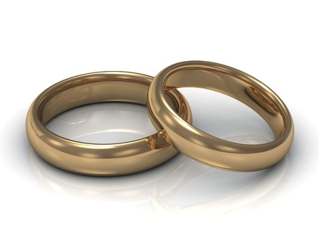 Wedding rings: one ring lies on the other on a white background photo