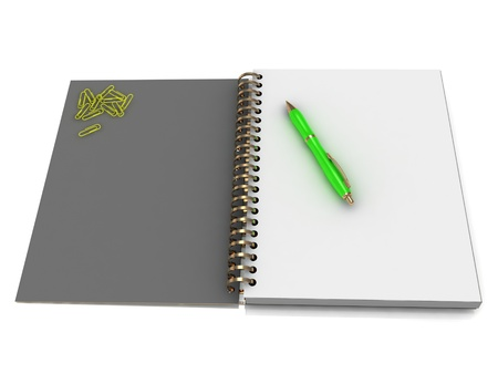 Notebook with a spiral, a handful of paper clips and a green pen on a white background photo