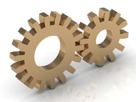 Two gold gears on a white background photo
