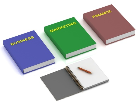 Notebook and three books on the economy on a white background photo