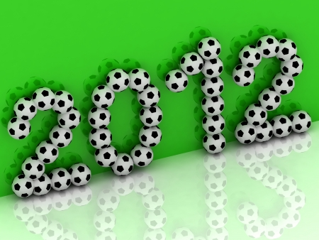 2012 of the soccer balls on a green background photo