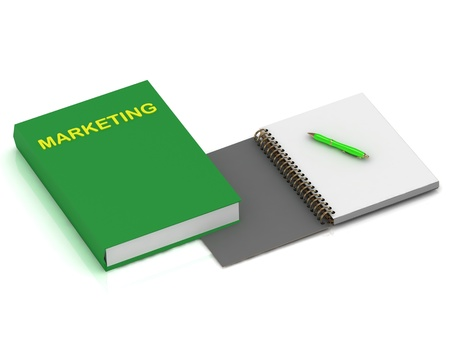 Notebook with a pen and a book on marketing on a white background photo