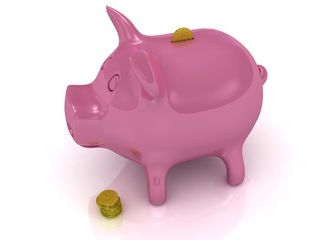Pink piggy bank and gold coins on a white background photo