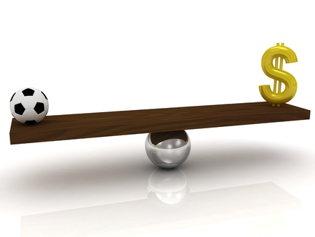 Soccer ball against the dollar in the balance  photo