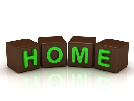 HOME inscription bright green letters on the cubes of chocolate isolated on white background photo