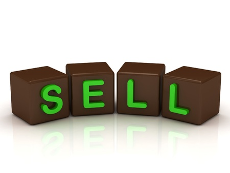 SELL inscription bright green letters on the cubes of chocolate isolated on white background photo