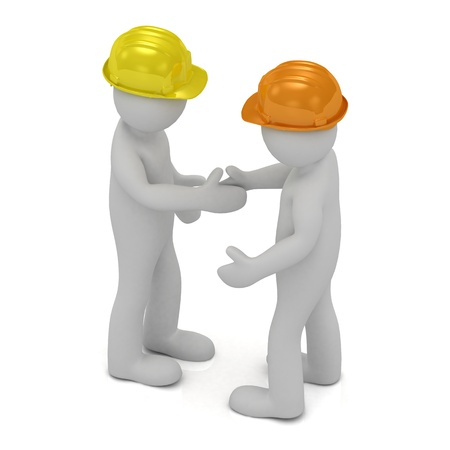 constructed: Two construction workers in hard hats shaking hands after putting constructed house