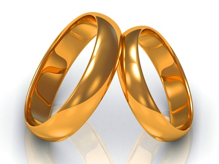 Two gold rings tilted at each other on white background