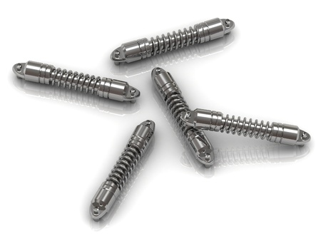 decelerator: Five nickel-plated motorcycle shock absorbers scattered on white background Stock Photo