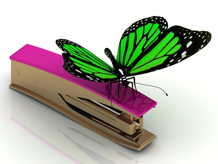 butterfly stationary: Golden Stapler with purple handle and a green butterfly Stock Photo