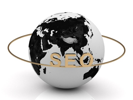 SEO gold letters on a gold ring around the earth photo